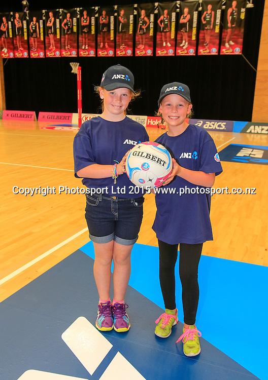 Future captains promotion - Elle Newman, 9 and Olivia Marshall, 10. Kia Magic v NSW Swifts, ANZ Netball Championship, ASB Stadium, Tauranga,  New Zealand. Monday, 09 March, 2015. Copyright photo: John Cowpland / www.photosport.co.nz