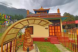 July 6, 2018 - Manali, Himachal Pradesh, India - A view of historical Buddhist temple 'Himalayan Nyinmapa Buddhist Monastery ' in Manali town , Himachal Pradesh , India on 6th July,2018. Himalayan Nyinmapa Buddhist Monastery is one of the famous Buddhist monastery in Manali. The main feature of the temple is the large statue of Sakyamuni, the historical Lord Buddha and beautiful wall paintings. The structure of the monastery is Pagoda style with yellow coloured top. (Credit Image: © Vishal Bhatnagar/NurPhoto via ZUMA Press)