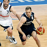 Fenerbahce's Omer ONAN (L) and Efes Pilsen's Igor RAKOCEVIC (R) during their Turkish Basketball Legague Play-Off semi final first match Fenerbahce between Efes Pilsen at the Sinan Erdem Arena in Istanbul Turkey on Tuesday 24 May 2011. Photo by TURKPIX