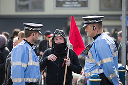 © Licensed to London News Pictures . 02/04/2016 . Dover , UK . Police liaison officers talk to an anti-fascist protester . Demonstrations by far-right groups (including The National Front , The North West Infidels and The South East Alliance ) and , opposing them , anti-fascists , close to the port of Dover in Kent . Photo credit : Joel Goodman/LNP