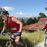 Seamus Costello (left) and Janet Siye in action in the bike leg of the Paradise Triathlon and Duathlon series, Paradise, Glenorchy, South Island, New Zealand. 18th February 2012. Photo Tim Clayton