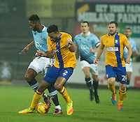 Jamille Matt of Blackpool battles with Rhys Bennett of Mansfield Town<br /> <br /> Photographer James Williamson/CameraSport<br /> <br /> The EFL Sky Bet League Two - Mansfield Town v Blackpool - Tuesday 22nd November 2016 - One Call Stadium - Mansfield<br /> <br /> World Copyright © 2016 CameraSport. All rights reserved. 43 Linden Ave. Countesthorpe. Leicester. England. LE8 5PG - Tel: +44 (0) 116 277 4147 - admin@camerasport.com - www.camerasport.com