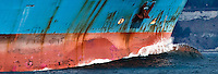 a cargo ship needing paint maintenance is arriving in Puget Sound, Washington, USA