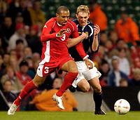 Photo: Richard Lane.<br /> Wales v Scotland. International Friendly. 18/02/2004.<br /> Danny Gabbidon of Wales battles with Darren Fletcher of Scotland.