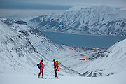 Michelle Blade (left) and Nate Stevens look back towards Longyearbyen from Larsbreen, Svalbard.