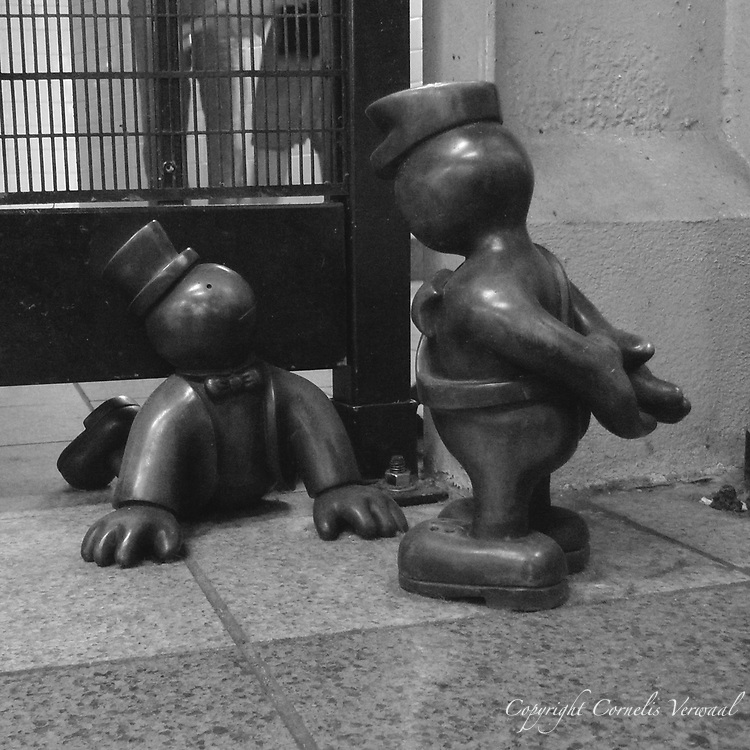 """""""Life Underground"""" - sculptures by Tom Otterness in the 14th St. and 8th Avenue subway station."""