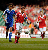 Photo: Leigh Quinnell.<br /> Wales v Slovakia. UEFA European Championships 2008 Qualifying. 07/10/2006. Craig Bellamy looks for the pass for Wales.