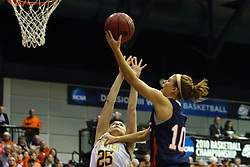 19 March 2010: Jenny Cowen lifts off and holds off Caroline Bernal-Silvey to finish off a break-a-way. The Flying Dutch of Hope College defeat the Yellowjackets of the University of Rochester in the semi-final round of the Division 3 Women's Basketball Championship by a score of 86-75 at the Shirk Center at Illinois Wesleyan in Bloomington Illinois.