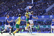 Cameron Jerome of Norwich City and Leighton Baines of Everton jump for the ball. Barclays Premier League match, Everton v Norwich City at Goodison Park in Liverpool on Sunday 15th May 2016.<br /> pic by Chris Stading, Andrew Orchard sports photography.