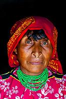 Kuna Indian woman wearing native costume (with nose ring) in her hut, Crab Island (Carti Sugdup), San Blas Islands (Kuna Yala), Caribbean Sea, Panama