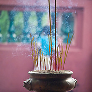 Incense burning in Jade Emperor Pagoda in Ho Chi Minh city, Vietnam. The temple is one of the most spectacularly colorful pagodas in the city.