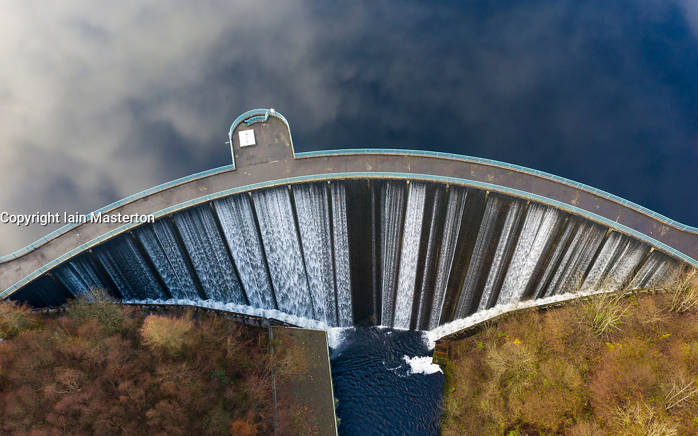 Glen Devon, Scotland, UK. 3 December 2020.  Aerial view of water from Castlehill reservoir  pouring over spillway on Castlehill Dam in Perth & Kinross. Iain Masterton/Alamy Live News