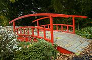 Red bridge in an Urban park in Paris, France