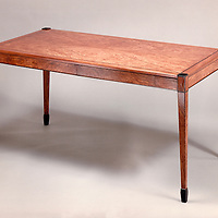 Curators desk<br /> Bubinga and Rosewood<br /> custom design build for a art curator for a client in Littleton, Co. Designed to sit on a handmade Frank Lloyd Wright designed rug.