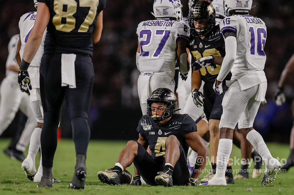 WEST LAFAYETTE, IN - SEPTEMBER 14: Rondale Moore #4 of the Purdue Boilermakers slowly gets up off the ground after a tackle during the first half against the TCU Horned Frogs at Ross-Ade Stadium on September 14, 2019 in West Lafayette, Indiana. (Photo by Michael Hickey/Getty Images) *** Local Caption *** Rondale Moore