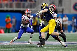 Florida Gators running back Kadarius Toney #4 runs the ball during the Chick-fil-A Peach Bowl, Saturday, December 29, 2018, in Atlanta. ( Paul Abell via Abell Images for Chick-fil-A Peach Bowl)