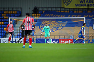 AFC Wimbledon goalkeeper Sam Walker (1) stood in the middle of the goal during the EFL Sky Bet League 1 match between AFC Wimbledon and Sunderland at Plough Lane, London, United Kingdom on 16 January 2021.