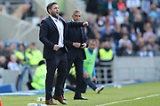 Bristol City manager Lee Johnson and Brighton Manager, Chris Hughton during the EFL Sky Bet Championship match between Brighton and Hove Albion and Bristol City at the American Express Community Stadium, Brighton and Hove, England on 29 April 2017.