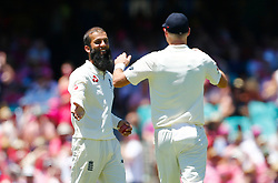 England's Moeen Ali celebrates the wicket of Australia's Steve Smith during day two of the Ashes Test match at Sydney Cricket Ground.