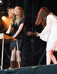 © Licensed to London News Pictures. 14/06/2015. Isle of Wight, UK.   First Aid Kit performing live at Isle of Wight Festival 2015, Day 4 Sunday.   In this picture - Johanna Soderberg. and Klara Soderberg.  Headline acts include The Prodigy, Blur and Fleetwood Mac.   Photo credit : Richard Isaac/LNP