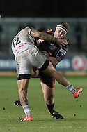 Phil Price of the Newport Gwent Dragons is tackled hard by Christopher Tuatara-Morrison of Brive. European Challenge cup pool 3 match, Newport Gwent Dragons v Brive, at Rodney Parade in Newport, South Wales on Friday 14th October 2016.<br /> pic by  Simon Latham, Andrew Orchard sports photography.