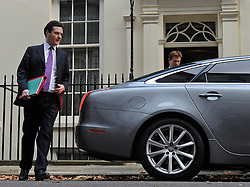© Licensed to London News Pictures. 29/11/2011, London, UK. Chancellor GEORGE OSBORNE and DANNY ALEXANDER  leaves 11 Downing Street today 29 November 2011 to deliver his Autumn Statement to the House.  Photo credit : Stephen Simpson/LNP