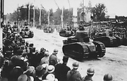 World War I 1914-1918: Postcard showing tanks travelling on road lined with people during  the French victory parade through Paris, 14 July 1919. France