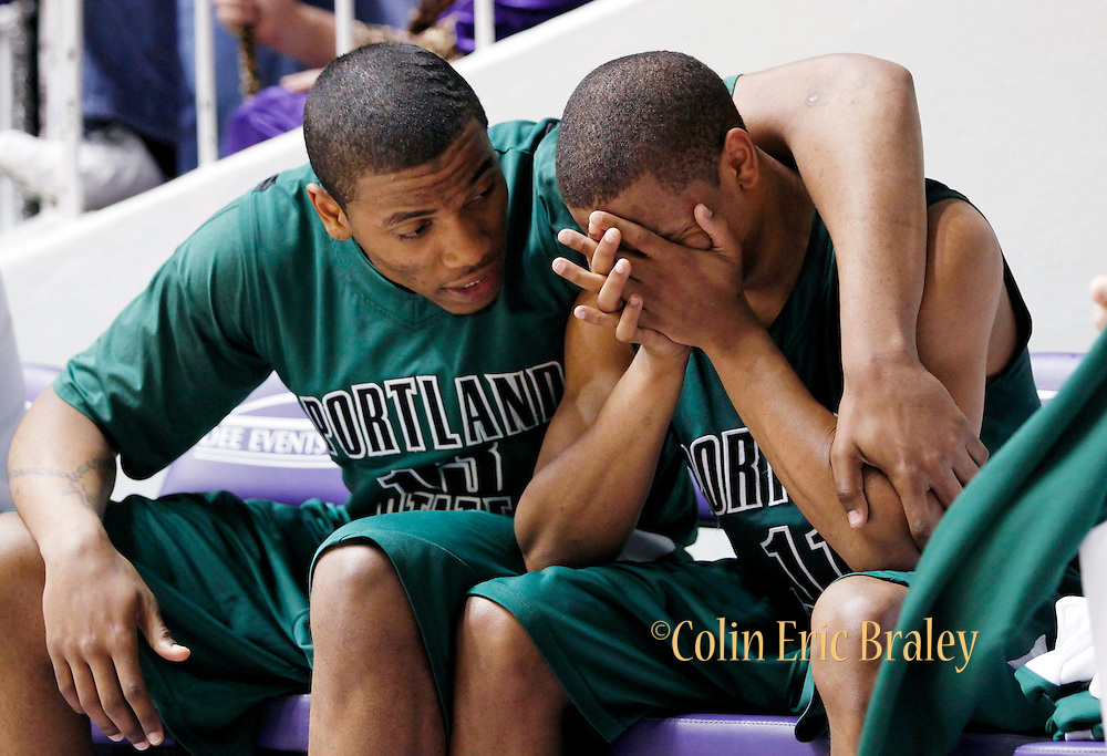 Portland State's Phillip Thomas, left, consoles his teammate Dominic Waters, right, after Waters fouled out in the final minutes of their Big Sky Conference tournament basketball game against Weber State, Tuesday, March 9, 2010 in Ogden, Utah. Weber State defeated Portland, 69-60. (AP Photo/Colin Braley)