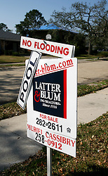 30 Jan, 2006. New Orleans, Louisiana.  Post Katrina.<br /> 5 months after hurricane Katrina smashed the city, for sale signs spring up in the Lakeshore neighbourhood, east of the 17th street levy breach. Many of the homes survived the storm unflooded, prompting a new attachment to 'For Sale' signs put up by realtors.<br /> Photo; Charlie Varley/varleypix.com