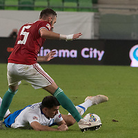 Attila Fiola (top) of Hungary and Lazaros Christodoulopoulos (bottom) of Greece fight for the ball during the UEFA Nations' League qualifying match between Hungary and Greece at the Groupama Arena stadium in Budapest, Hungary on Sept. 11, 2018. ATTILA VOLGYI