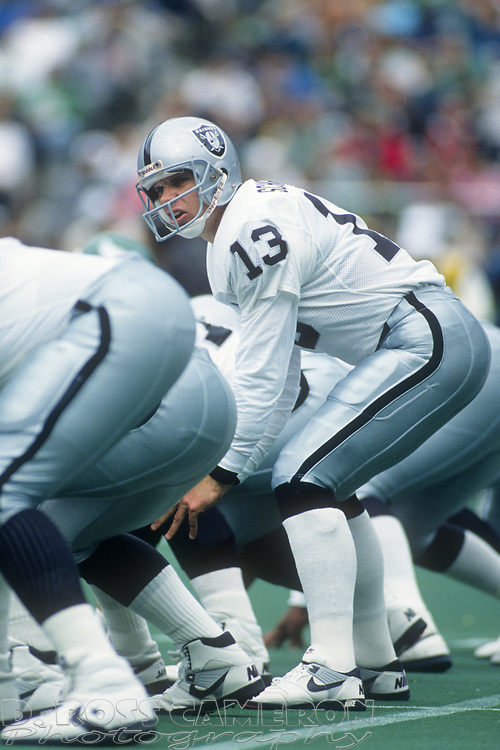 Los Angeles Raiders quarterback Jay Schroeder lines up behind center during an NFL football game against the Philadelphia Eagles, Sunday, Oct. 22, 1989 at Veterans Stadium in Philadelphia, Pa. The Eagles won, 10-7. (Photo by D. Ross Cameron)