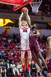 NORMAL, IL - November 10:  Taylor Bruninga takes the ball to the hoop defended by Ruot Monyyong during a college basketball game between the ISU Redbirds and the Little Rock Trojans on November 10 2019 at Redbird Arena in Normal, IL. (Photo by Alan Look)