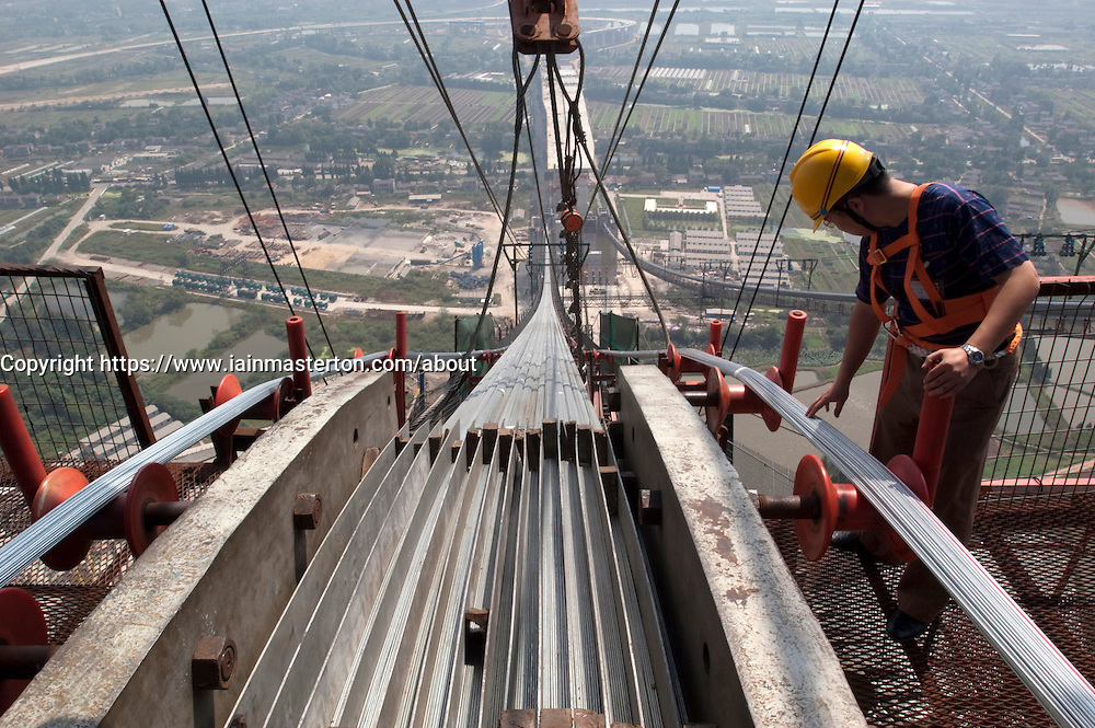 Inspecting suspension bridge saddle at Runyang Bridge in China currenly the longest bridge in China