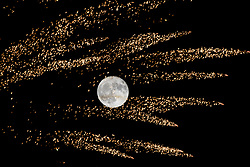 © London News Pictures. A Super Moon shares the sky with a fireworks display in Oxford, November 4, 2017 during celebrations for Guy Forks night, also known as bonfire night, the anniversary of the gunpowder plot to blow up the Houses of Parliament in London.. Photo by Andre Camara/LNP