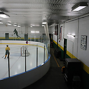 The shirt of Jonathan Quick  hangs on the wall as Hamden High School ice hockey players during a training session at Hamden High School,  Hamden, Connecticut, USA. 20th February 2014. Photo Tim Clayton