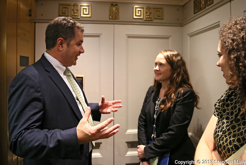 Representative Bruce Braley (D-IA) talks Katy Siddall, Legislative Assistant, and Kira Ayish, Press Secretary, in an elevator following a meeting in the Rayburn House Office Building in Washington, DC on Wednesday, April 10, 2013.