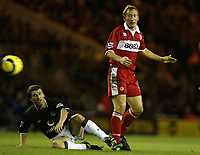 The FA Barclays Premiership<br />1 January 2005, The Riverside, Stadium, Middlesbrough<br />Middlesbrough v Manchester United<br />Manchester United's Roy keane is beaten to the ball by Middlesbrough's Ray Parlour<br />Pic Jason Cairnduff/Back Page Images