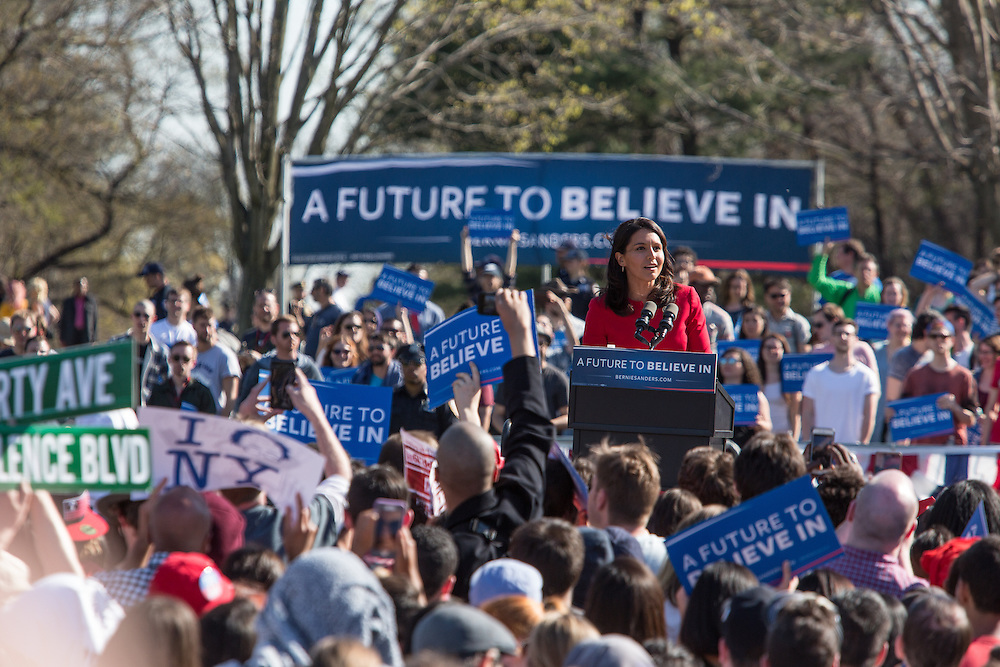 """Brooklyn, NY - 17 April 2016. Hawaii Congresswoman Tulsi Gabbard spoke in support of Sanders' candidacy. Vermont Senator Bernie Sanders, who is running as a Democrat in the U.S. Presidential primary elections, held a campaign """"get out the  vote"""" rally in Brooklyn's Prospect Park."""