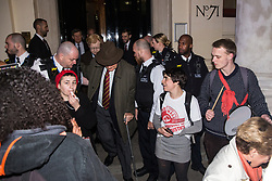 London, UK. 12th February, 2019. Members and supporters of grassroots trade union United Voices of the World move aside to allow a man and woman through during a protest outside the Gadson Club in Pall Mall London, UK. 12th February, 2019. Members and supporters of grassroots trade union United Voices of the World protest outside the Gadson Club in Pall Mall on the occasion of a reception with Justice Secretary David Gauke against his refusal to negotiate with the trade union over their demands for the London Living Wage, annual leave and sick pay for outsourced cleaners, security guards and receptionists working at the Ministry of Justice, all of whom have been on strike for varying periods recently. The Gadson Club is the official alumni club for the Oxford University Conservative Association.