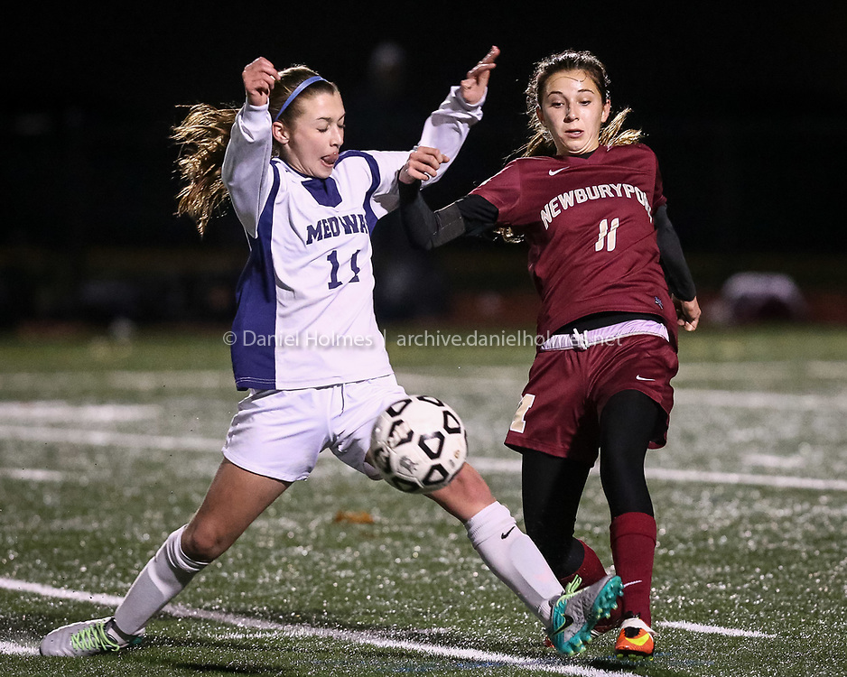 (11/16/16, WESTWOOD, MA) Medway's Audrey Cobb, left, and Newburyport's Margaret Cote fight for the ball during the Division 3 state semifinals against at Westwood High School on Wednesday. Daily News and Wicked Local Photo/Dan Holmes
