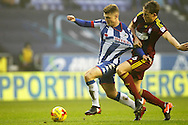 Wigan's Max Power (6) and Ipswich's Christophe Berra (6)  during the EFL Sky Bet Championship match between Wigan Athletic and Ipswich Town at the DW Stadium, Wigan, England on 17 December 2016. Photo by Craig Galloway.