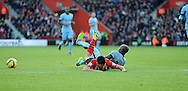 Eliaquim Mangala of Manchester City fouls Shane Long of Southampton for his 2nd yellow card<br /> - Barclays Premier League - Southampton vs Manchester City - St Mary's Stadium - Southampton - England - 30th November 2014 - Pic Robin Parker/Sportimage