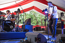 """© Licensed to London News Pictures . 20/07/2013 . Suffolk , UK . """" Drenge """" (consisting of singer and guitarist Eoin Loveless and his brother Rory Loveless on drums ) . Drenge reached wide prominence at the start of July when MP Tom Watson cited them in his letter of resignation to Ed Miliband , over a row over the Labour Party's Falkirk selection process . The Latitude music and culture festival in Henham Park , Southwold . Photo credit : Joel Goodman/LNP"""