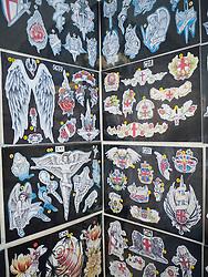 Display of tattoo designs in tattoo parlour