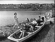 Carna. Boat Bulding with the Cloherty family 14th May 1959. Children playing in a boat.<br /> Carna. Saoirseacht Bád le Clann Uí Chlochartaigh, 14ú Bealtaine 1959. Gasúir ag spraoi i mbád.