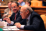 Chairman Alan Simpson speaks and Chairman Erskin Bowles listens at a meeting on the National  Commission  on Fiscal Responsibility and Reform. Photograph by Dennis Brack