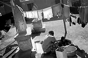 Cairo, Egypt, The City of the Dead, 2000 - Washing and hanging laundry among the graves.