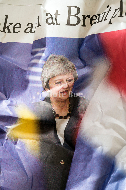 crumpled newspaper with portrait of English Prime Minister Theresa May