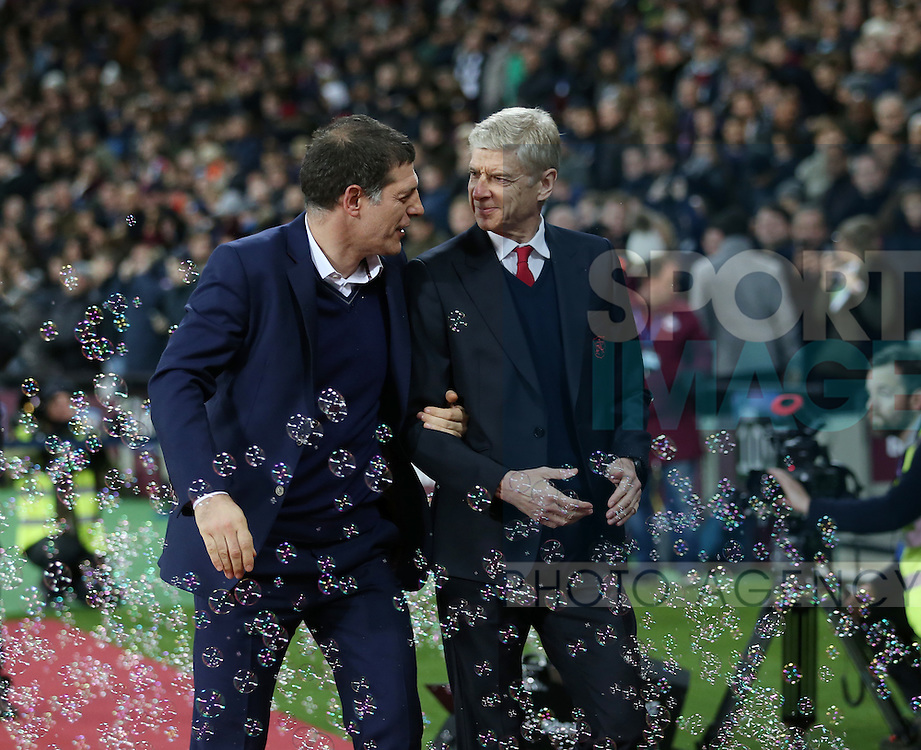 West Ham's Slaven Bilic with Arsenal's Arsene Wenger during the Premier League match at the London Stadium, London. Picture date December 3rd, 2016 Pic David Klein/Sportimage