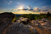 The late afternoon sun dips behind a cloud in this view from Ruffner Mountain, Birmingham, Alabama. The area was once home to iron ore mines and limestone quarries, but was set aside for nature conservation in 1977.